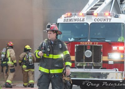 Longwood Firefighter in front of Seminole county fire truck