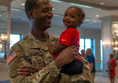 Florida National Guard officer with child